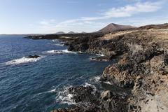 Volcanic cliffs near los cocoteros, lanzarote, canary islands, spain, europe Stock Photos