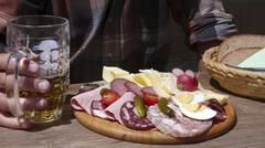 bavarian vespers, a snack with typical local sausages and a cheese platter - stock photo