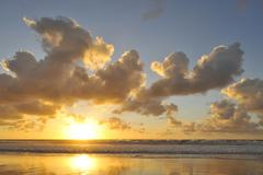 Sunset and cloudy sky with reflection on the atlantic ocean, el cotillo, fuer Stock Photos