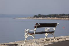 Bench in tovarnele, pag island, dalmatia, adriatic sea, croatia, europe Stock Photos