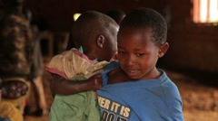 African Child Taking Care of His Little Sister in Batwa Tribe, Uganda, Africa Stock Footage