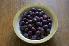 plums in a bowl - stock photo