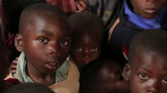 African Little Boys from Batwa Tribe Looking at Camera in Uganda, Africa - stock footage