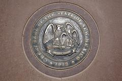 Four corners monument, seal of the state of new mexico, federal border quadra Stock Photos