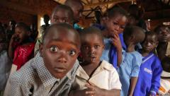 African Boys from Batwa Tribe Looking at Camera in Uganda, Africa Stock Footage