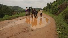 African Children from Batwa Tribe Running Through Puddle, Uganda Stock Footage
