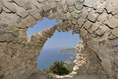 ruins of a church with a barrel vault, castle hill monólithos, rhodes, greec - stock photo