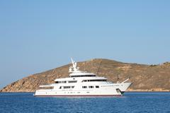 Luxury big mega motor yacht in the blue sea. Stock Photos