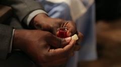 African Man Serving Communion in Church in Kabale, Uganda - stock footage