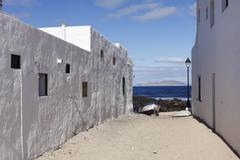 Caleta de famara, lanzarote, la graciiosa island in the back, canary islands, Stock Photos