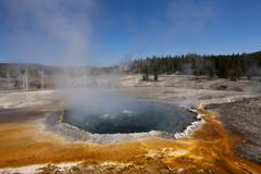 crested pool with colourful thermophilic microorganisms and algae, upper geys - stock photo