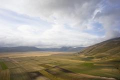 Stock Photo of high above piano grande plateau, monte sibillini, apennines, le marche, italy