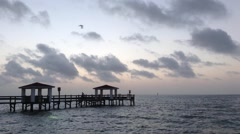 Sunrise at fishing pier Stock Footage