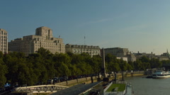 Shell building and Cleopatra's Needle on London embankment. Wide shot. HD Stock Footage