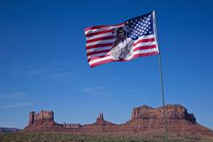 navajo flag with views of monument valley, colorado plateau, navajo nation re - stock photo
