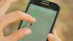 Close-up of phone screen, searching for the address in Google Maps Stock Footage