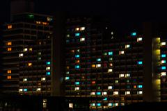 Night colorful windows lights in residential building Stock Photos