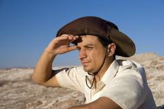 young man, 25 +, looking out in the atacama desert, chile, south america - stock photo