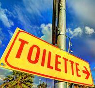 Toilette metal sign Stock Photos