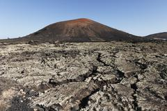 montaña negra volcano, lava field, lanzarote, canary islands, spain, europe - stock photo