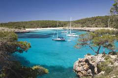 Sailing yachts anchoring in the bay of s\'amarador, cala mondragó, natural p Stock Photos