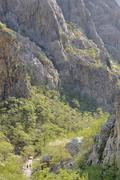 View into the velika paklenica canyon with hikers in paklenica national park, Stock Photos