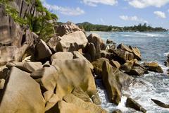 Granite rocks at the sea, island of la digue, seychelles, africa, indian ocea Stock Photos