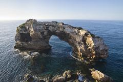 archway of es pontas, cala santanyi bay, mediterranean sea, mallorca, majorca - stock photo