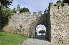 Archway in the medieval city walls of evora, unesco world heritage site, alen Stock Photos
