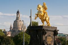 Golden rider equestrian statue in front of frauenkirche, church of our lady,  Stock Photos