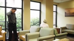 Family in waiting room Stock Footage