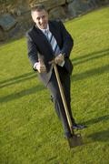 Businessman cutting the first sod Stock Photos