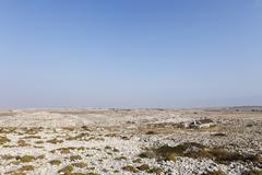 barren landscape at smokvica, pag island, dalmatia, adriatic sea, croatia, eu - stock photo