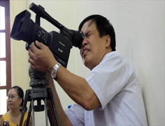Journalist work with professional camera, Asia Stock Footage