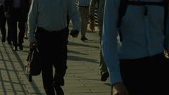 Crowd of pedestrians walk over Golden Jubilee Bridge, London. HD version Stock Footage