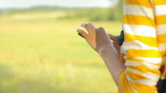 Young tourist using cell phone outdoors, traveling, nature, camera movement Stock Footage