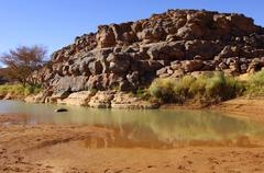 Stock Photo of water rest in a riverbed near the prehistoric archaeological sites in wadi ma