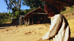 Elderly Burmese woman from tribal minority sitting peacefully - stock footage