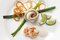 Halibut rolls with scampi and vegetables Kuvituskuvat
