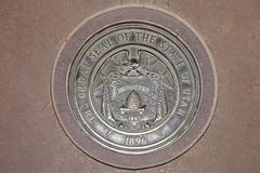 Four corners monument, seal of the state of utah, federal border quadrangle f Stock Photos