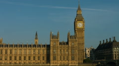 Houses of Parliament MS tilt down to River Thames. HD version - stock footage