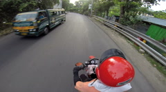 Point of view motorcycle ride along street Stock Footage