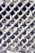 chain-link fence with hoarfrost, snow and ice - stock photo