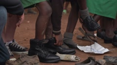 African School Children Receiving New Shoes, Uganda - stock footage