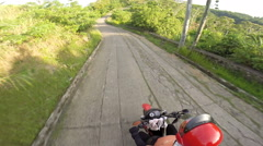 Point of view motorcycle ride along dirt road Stock Footage