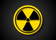 Nuclear radiation vector symbol - stock illustration