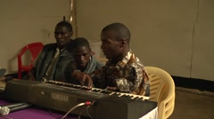 African Disabled Man Playing the Piano in Kabale, Uganda Stock Footage
