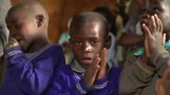African Boys from Batwa Tribe Singing and Applauding in Uganda, Africa - stock footage