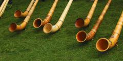 Swiss alphorns at a swiss folk festival, valais, switzerland, europe Stock Photos