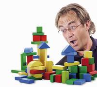 Building bricks, man gaping Stock Photos